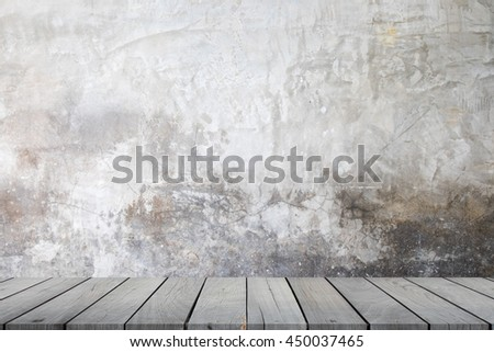 Abstract empty interior background with grungy concrete wall and wooden floor