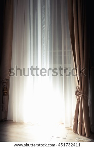 Abstract empty interior fragment, curtains and closed blinds with bright back light spot - stock photo