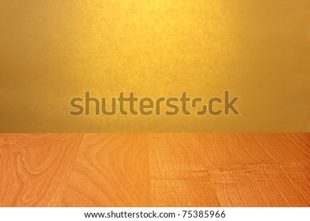 Abstract empty wooden desk background against yellow wall - stock photo