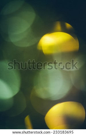 Abstract Festive background.Christmas and New Year feast bokeh background with copyspace. Holiday party background with blurry boke special magic effect.. Vintage effect. Retro grainy color film look. - stock photo