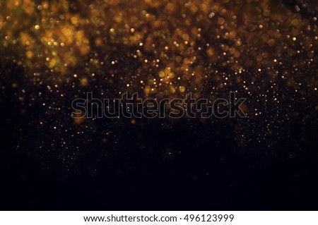 Abstract Festive background. Glitter vintage lights background with lights defocused. Christmas and New Year feast bokeh background