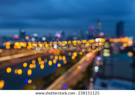 Abstract festive background with bokeh defocused lights of downtown of  Ho Chi Minh City ( Sai Gon ) , Vietnam from high view at  in sunset or sunrise - stock photo