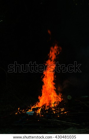 Abstract Fire flame on black background,tongues of flame, red wild fire on black background, Fire flames on a black background - stock photo