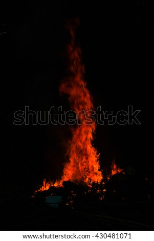 Abstract Fire flame on black background,tongues of flame,red wild fire on black background,Fire flames on a black background - stock photo