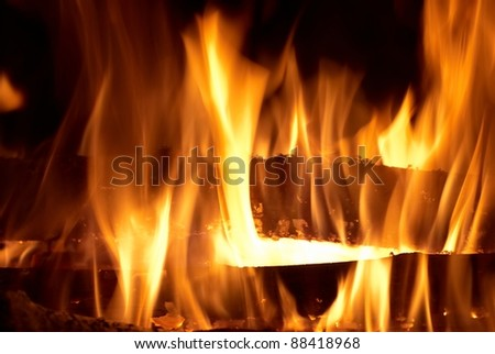 Abstract fire isolated on the black background - stock photo