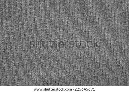 abstract fluffy texture of soft knitted fabric from a wool yarn with a pattern in the form of a herringbone for backgrounds of black color - stock photo