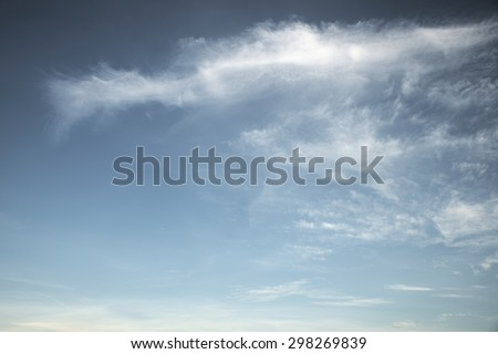 Abstract fluffy white cloud over blue sky background - stock photo