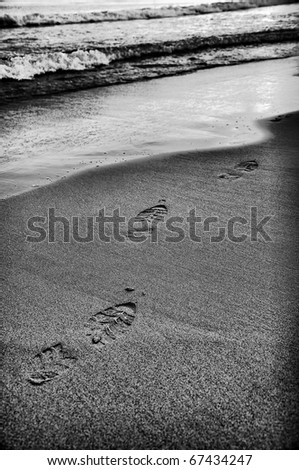 abstract footprint in sand on beach - stock photo