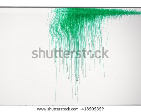 Abstract form of green color in water, isolated on white background.  - stock photo