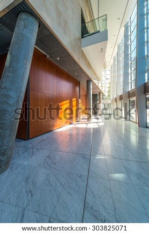 Abstract fragment of the urban architecture of modern luxury building, center, hotel, shopping mall, business centre. Interior design. Vertical.