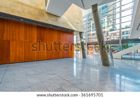 Abstract fragment of the urban architecture of modern luxury building, center, hotel, shopping mall, business center. Interior design. Vertical. - stock photo