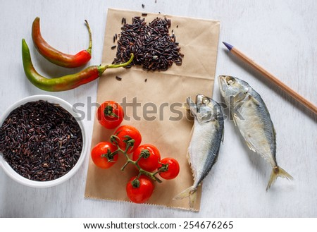 Abstract fresh organic vegetables with riceberry on vintage white table food background. Healthy food from garden and paper for notes.Project healthy living. - stock photo