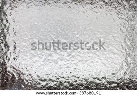 Abstract frosty icy pattern on a dark glass. - stock photo