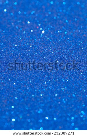 Abstract full frame view of sparkling blue glitter shining with galaxy stars. Festive and celebration blue glitter texture and detail background. Artistic crafts and inspiration. - stock photo
