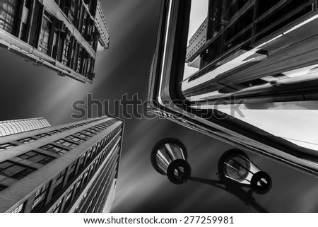 Abstract futuristic cityscape view with modern skyscrapers and street lamp under cloudy night sky. Hong Kong - stock photo