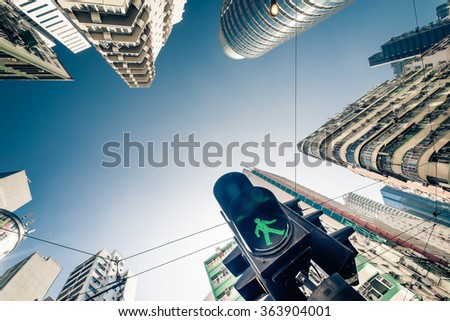 Abstract futuristic cityscape view with modern skyscrapers and traffic semaphore - stock photo