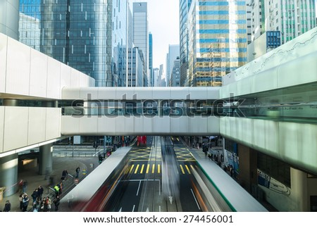 Abstract futuristic cityscape view with modern skyscrapers, bridge and walking people. Hong Kong - stock photo