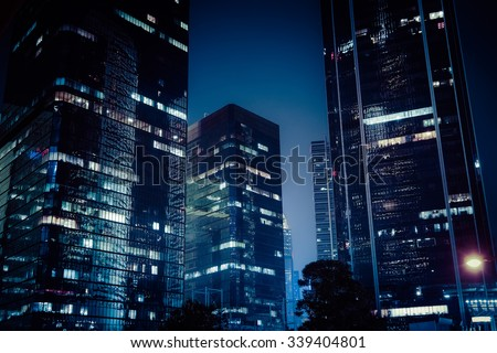 Abstract futuristic night cityscape with illuminated skyscrapers. Hong Kong - stock photo