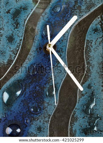 abstract glass fusion wall clock with white pointers   - stock photo