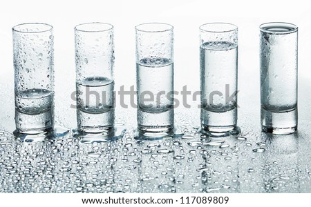 Abstract glasses for drink in water drops - stock photo