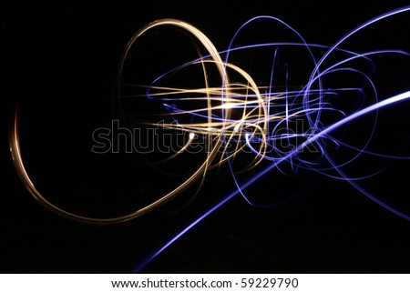 Abstract glowing background showing motion blurred neon light curves in blue and gold