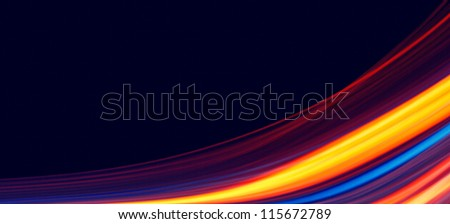 Abstract glowing lines of light. Colourful background - stock photo