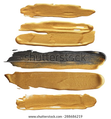 Abstract gold acrylic and watercolor brush strokes. - stock photo