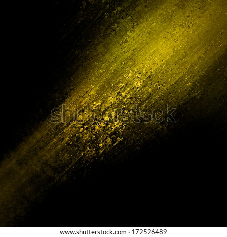 abstract gold background design, rough black border with gold streak or stream of bright light across dark contrasting black background, unique web design background or elegant brochure layout space - stock photo