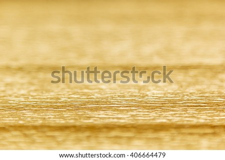 Abstract gold background with blur. The texture. - stock photo
