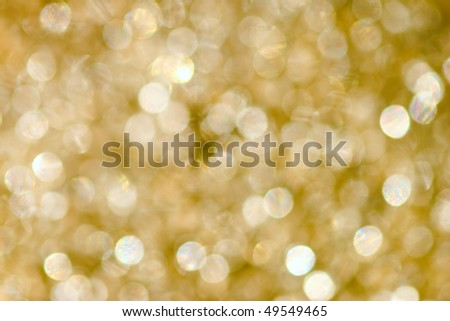 Abstract gold  background with bokeh effect - stock photo