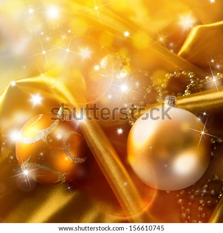 Abstract gold background with christmas balls on luxury cloth