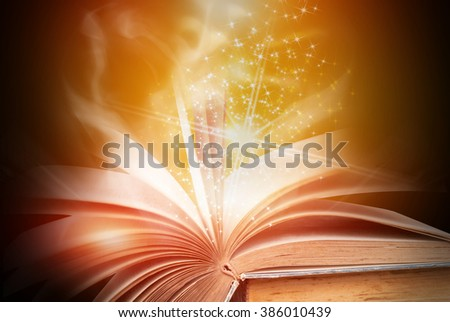Abstract gold magic book on wooden background - stock photo