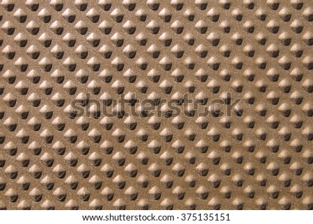 Abstract gold textured background with a decorative pattern. - stock photo
