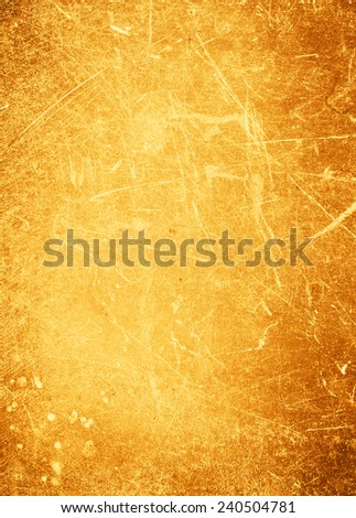 Abstract gold textured  background with spotlight and scratches. Yellow grunge wall closeup for design. Grungy  backdrop. - stock photo