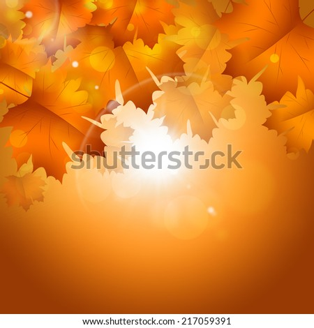 abstract golden autumn sunny background with falling leaves