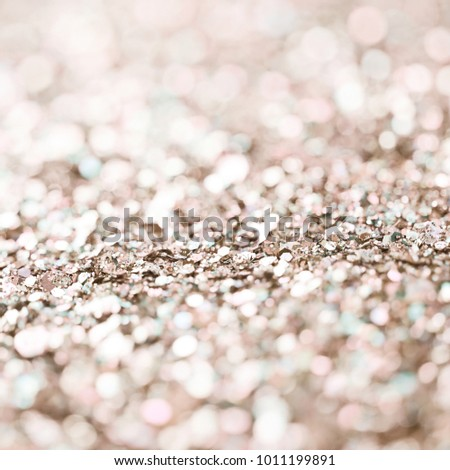 Abstract golden colored background composition made of pile of tinsel shot in bokeh as a backdrop