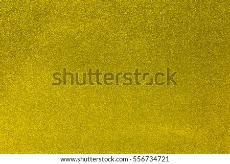 Abstract golden glitter texture background. Glowing shiny paper for warp your gift box or party decoration.