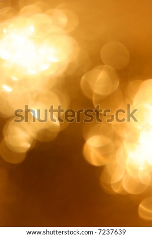 Abstract golden glow light background. Defocused shot of christmas ornament - stock photo