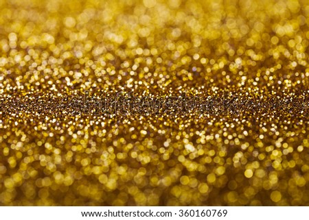 Abstract golden holidays twinkle lights on background. - stock photo