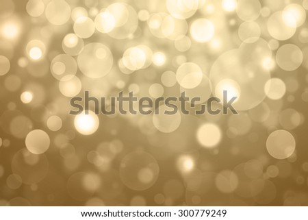 abstract golden light burst and glitter bokeh. - stock photo