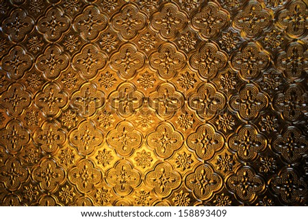 Abstract graphic textured background brown glass - stock photo
