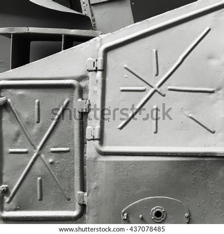 Abstract gray industrial metal background texture with manholes, details of Russian armored train from WWII time - stock photo