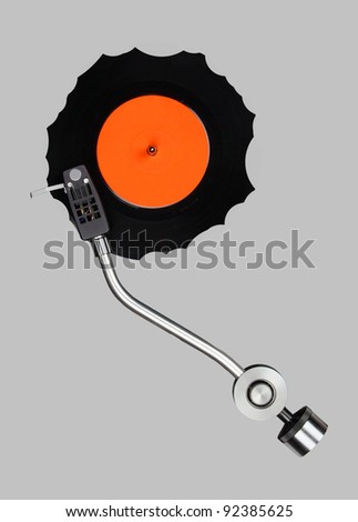 Abstract grazed vinyl with record player tonearm isolated. - stock photo