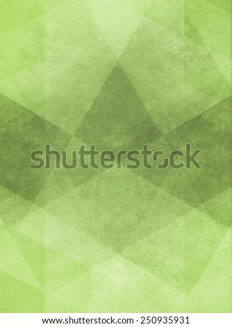 abstract green background design of angled squares blocks triangles and diamond shapes in random pattern with distressed faded vintage background texture - stock photo
