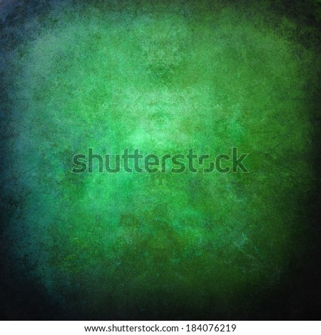 abstract green background or Christmas background with bright center spotlight and black vignette border frame - stock photo