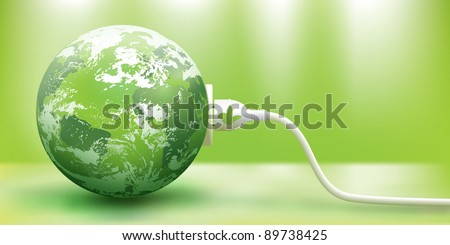 abstract green energy concept with green Earth and plug - stock photo