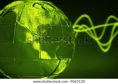 abstract green glass globe & wave pattern (water inside and small bubbles) - stock photo