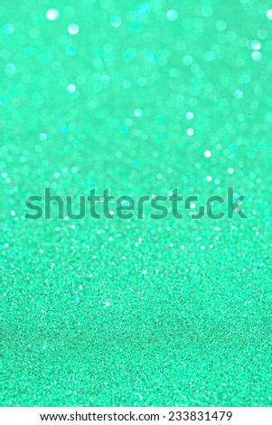 Abstract green glitter festive background texture with shining glitter stars. Full frame aqua blue color christmas detail with blurred areas. Artistic colorful background drop frame. - stock photo