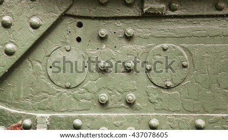 Abstract green industrial metal background texture with bolts and rivets - stock photo