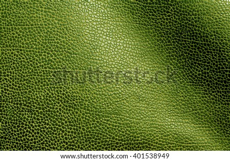 Abstract green leather texture. Background and texture for design. - stock photo